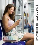 Young Woman Using Smartphone I...