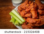 chicken buffalo wings with... | Shutterstock . vector #215326408