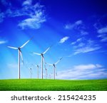 green meadow with wind turbines | Shutterstock . vector #215424235