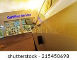 Car Service Auto Care Center. Car in Front of Two Gates to Authorized Certified Auto Service. - stock photo
