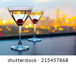 Stock photo cocktail glasses with city view 215457868