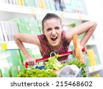 angry woman pushing a full... | Shutterstock . vector #215468602