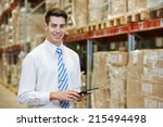 smiling manager in warehouse... | Shutterstock . vector #215494498