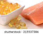 Fish Oil Capsules And Salmon...