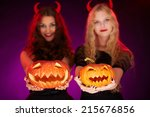 two carved halloween pumpkins... | Shutterstock . vector #215676856