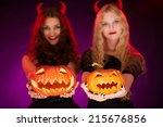 two carved halloween pumpkins... | Shutterstock . vector #215676856
