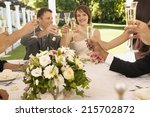 people having fun at wedding... | Shutterstock . vector #215702872