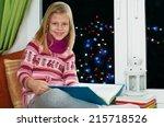 cute little girl reading a book ... | Shutterstock . vector #215718526