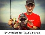 Stock photo happy angler with zander fishing trophy 215854786