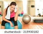 Fitness Woman In Gym Resting O...
