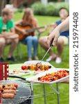 party in a garden during summer ... | Shutterstock . vector #215974408