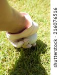 placing a golf ball on a tee | Shutterstock . vector #216076516
