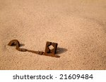 A Rusty Old Key Buried In The...