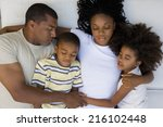 family of four sleeping on... | Shutterstock . vector #216102448