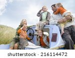 young family sitting on boat at ... | Shutterstock . vector #216114472