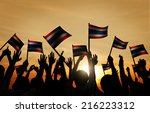 group of people waving flag of... | Shutterstock . vector #216223312
