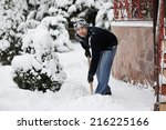 Handsome Young Man Shoveling...