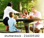 family of four eating at... | Shutterstock . vector #216335182
