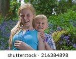 children sitting on log among... | Shutterstock . vector #216384898