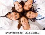 happy group of doctors smiling... | Shutterstock . vector #21638863