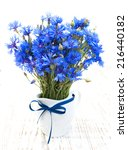 Blue Cornflowers On A Old Whit...