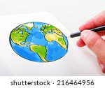 hand drawning earth in a notepad
