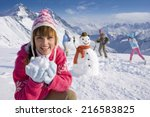 Family Building Snowman...