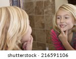 Child Looking In Mirror And...
