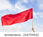 Hand Waving A Red Flag With...