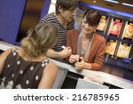 a couple buying movie tickets... | Shutterstock . vector #216785965