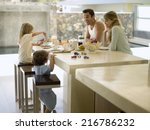 a family having breakfast. | Shutterstock . vector #216786232