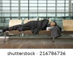 a businessman asleep in airport ...