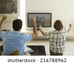 father and son watching tv. | Shutterstock . vector #216788962