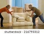 a couple adjusting an armchair | Shutterstock . vector #216793312