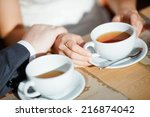 hands of men and women who... | Shutterstock . vector #216874042