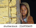 Stock photo madagascar shy and poor african girl with headkerchief 216950605