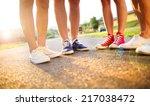 legs and sneakers of teenage... | Shutterstock . vector #217038472
