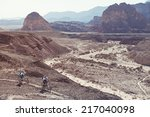 Two Mountain Bikers In The...