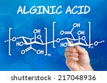 Small photo of Hand with pen drawing the chemical formula of Alginic acid