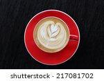 hot latte coffee on wooden... | Shutterstock . vector #217081702