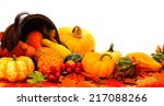 Harvest basket with spilling autumn pumpkins and vegetables - stock photo