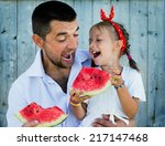 happy father playing with cute... | Shutterstock . vector #217147468