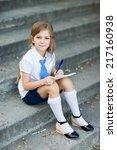 little girl writting in... | Shutterstock . vector #217160938