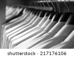 shirts hanging stack close up  | Shutterstock . vector #217176106