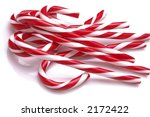 A Pile Of Candy Canes On A...