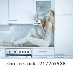 side view of young woman eating ... | Shutterstock . vector #217259938
