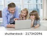 happy father showing something... | Shutterstock . vector #217342096