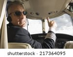 pilot making thumbs up sign in... | Shutterstock . vector #217364095