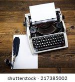 retro typewriter with white... | Shutterstock . vector #217385002