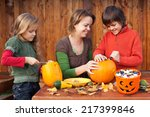Woman Helping Kids To Carve...